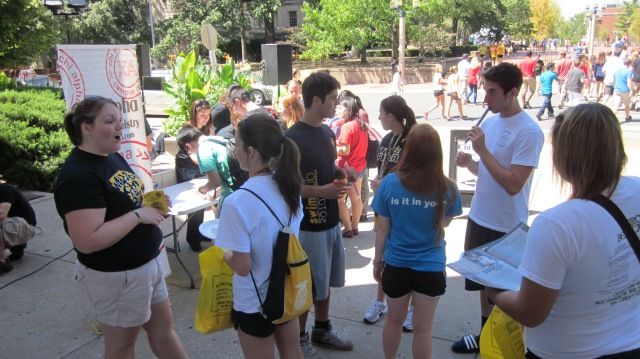 A Chi Alpha staff member talks to students at our popsicle giveaway contact event